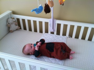 Henry loves his mobile, but he's not so sure about the crib yet!